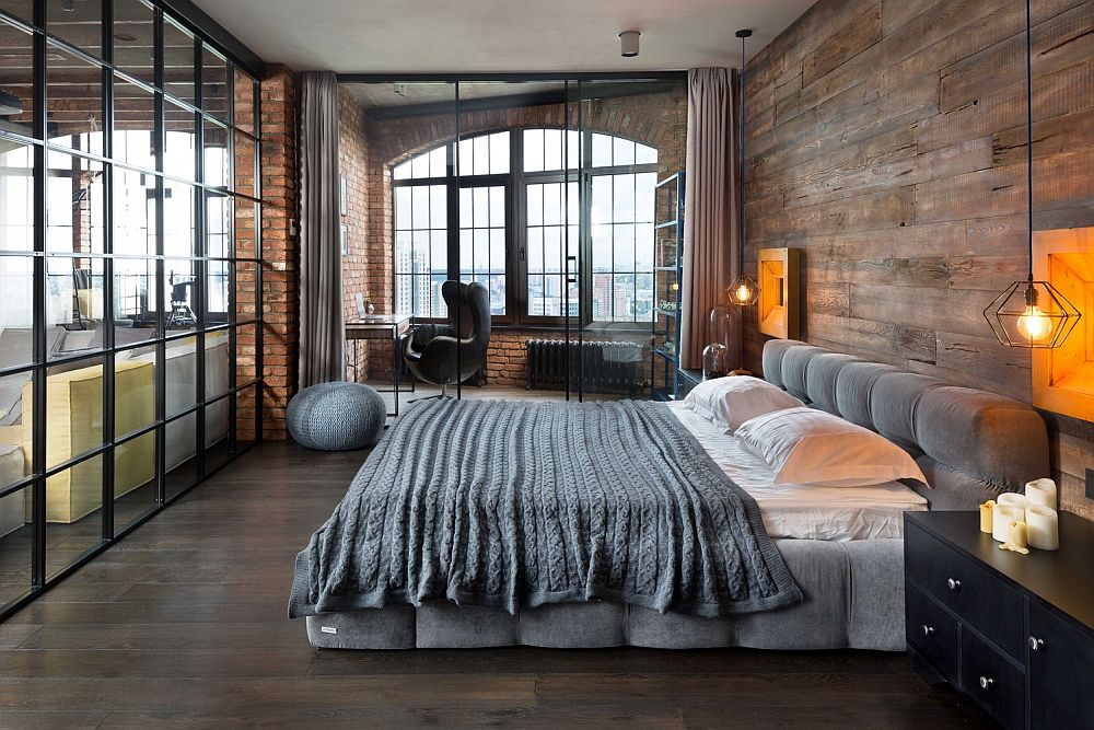 Bachelor bedroom inside loft apartment with bedside pendants, wooden and glass walls
