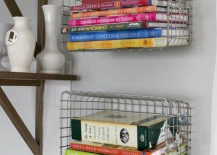 Baskets attached to walls as cookbook shelving