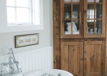 Beach style bathroom with a built-in corner cabinet