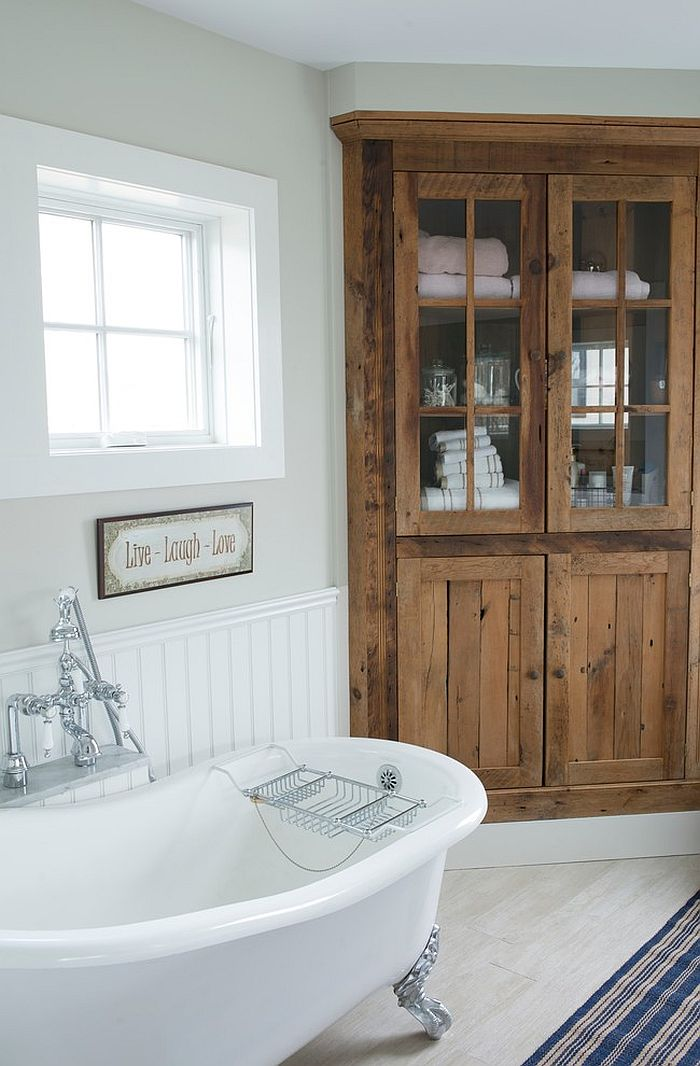 Beach style bathroom with a built-in corner cabinet [Design: Bensonwood]