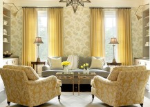 Beach-style-family-room-with-twin-coffee-tables-in-gold-leaf-and-glass-217x155