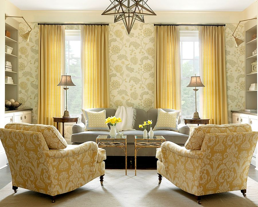 Beach style family room with twin coffee tables in gold leaf and glass