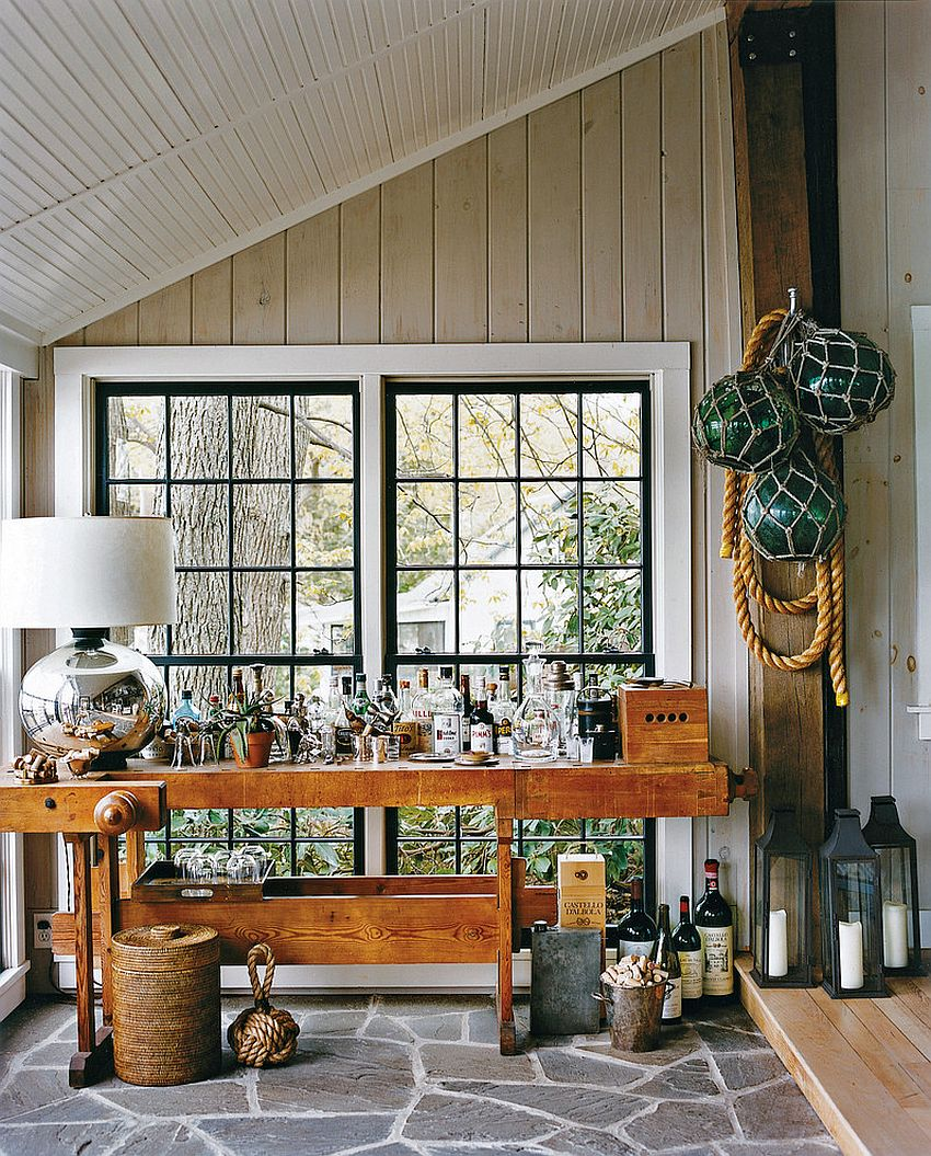 Beautiful bar on the rustic porch is all geared up for fun fall parties [Design: Thom Filicia]