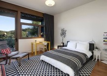 Beautiful bedroom design with geometric rug
