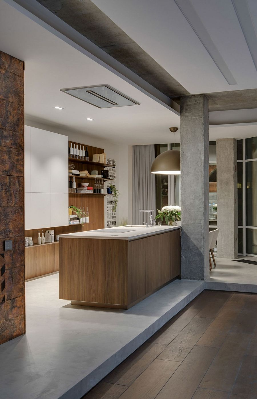 Beautiful kitchen design with large industrial lighting and floating wooden shelves