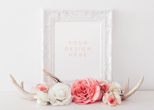 Beautiful white pictures frame with deer antlers
