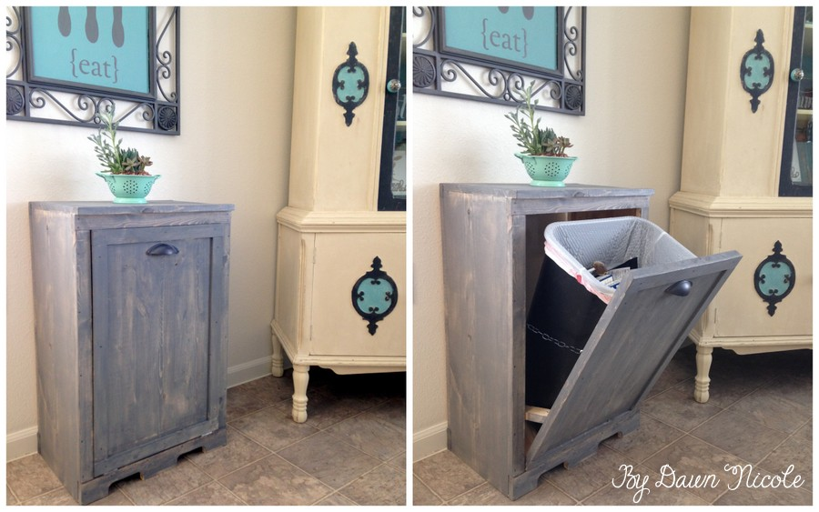 View in gallery Beautiful wood tilt to hide a trash can 8 Ways Hide or Dress Up an Ugly Kitchen Trash Can
