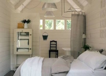 Bedroom and bathroom in an attic 217x155 15 Attics Turned into Breathtaking Bathrooms