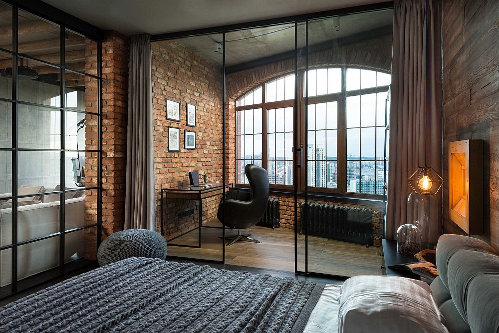 Bedroom with a charming workspace behind glass partition
