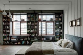 Bedroom with bookshelf and Tom Dixon pendants