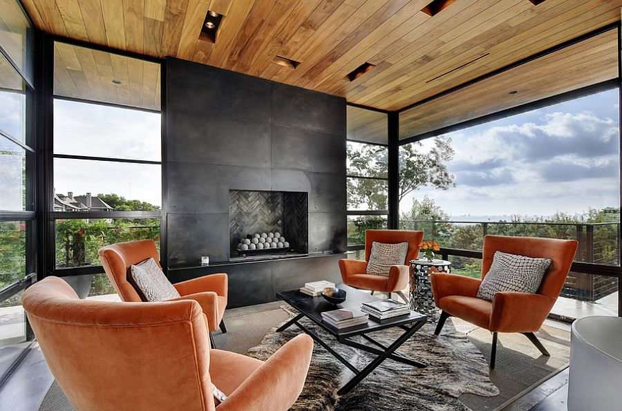 Black fireplace and wooden roof for the spacious sunroom [From: Twist Tours Photography]  50 Bright and Beautiful Contemporary Sunrooms Black fireplace and wooden roof for the spacious sunroom