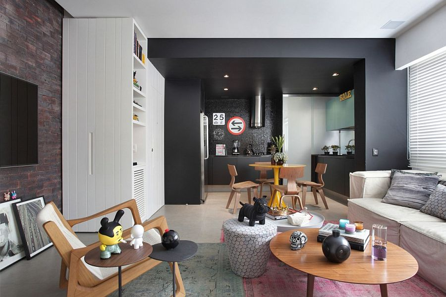 Black kithen area demarcates space without using walls VF House: Enigmatic Rio Residence Shaped by Eclectic Decor and Bold Choices