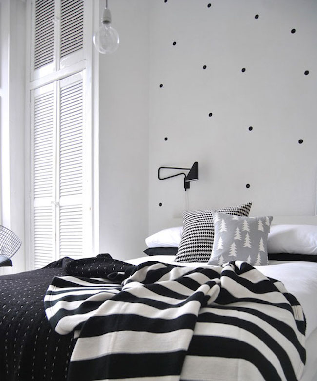 Black polka dot wall decals combined with other bedding patterns