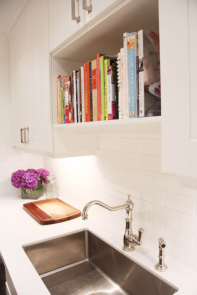 Medium image of view in gallery bookshelf directly above kitchen sink
