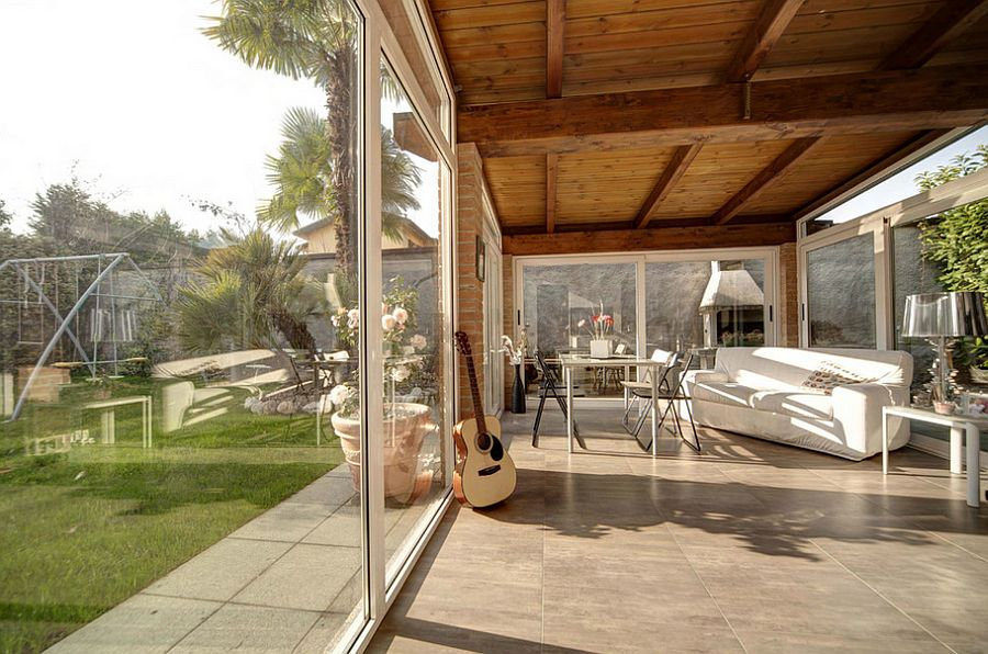 Brick walls bring elegance and timeless charm to the classy, contemporary sunroom [Design: I.D. Studio Interior Design]