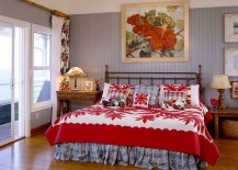 Bright, fabulous bedding and wall art in red highlight the tropical theme
