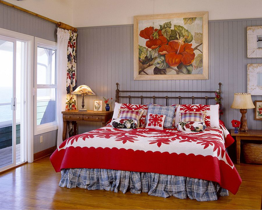 Bright, fabulous bedding and wall art in red highlight the tropical theme [Design: Cynthia Marks]