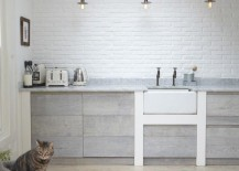 Bright modern kitchen with a herringbone floor 217x155 Create a Chic Statement with a White Brick Wall