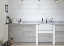 Bright-modern-kitchen-with-a-herringbone-floor-217x155