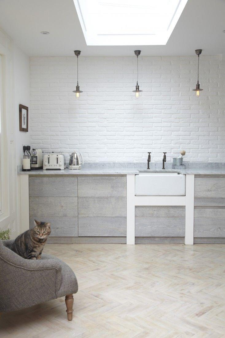 Bright modern kitchen with a herringbone floor