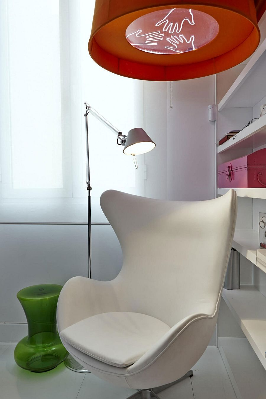 Bright red lighting above the Arne Jacobsen Egg Chair