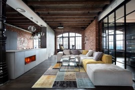 Brilliant Kiev loft living space with brick and glass walls and a wooden ceiling