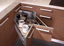 Butterfly corner drawers in the kitchen help tuck away those extra pots and pans 217x155 30 Corner Drawers and Storage Solutions for the Modern Kitchen