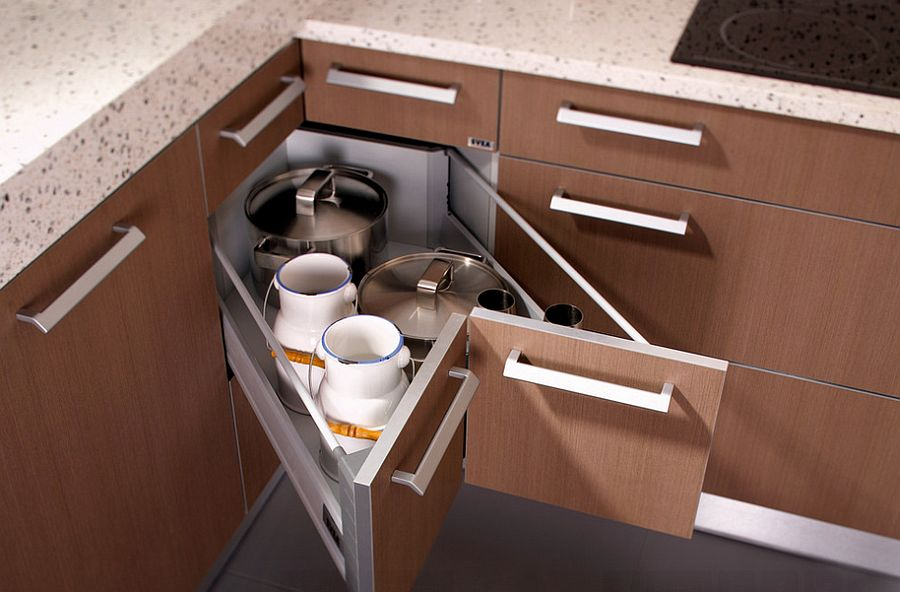 Butterfly corner drawers in the kitchen help tuck away those extra pots and pans [Design: SVEA KITCHENS]