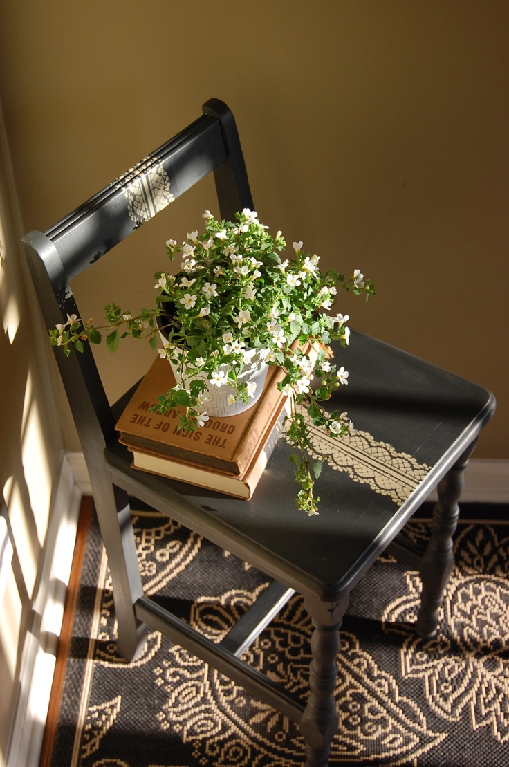 Chair dressed up with gold lace design