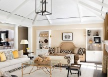 Cheerful and relaxing beach style living room with a gold coffee table [Design: Weaver Design Group]