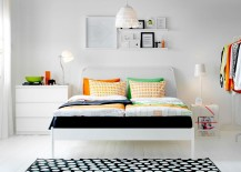 Chic bedroom with pops of color, sleek DUKEN bed and stylish IKEA side table