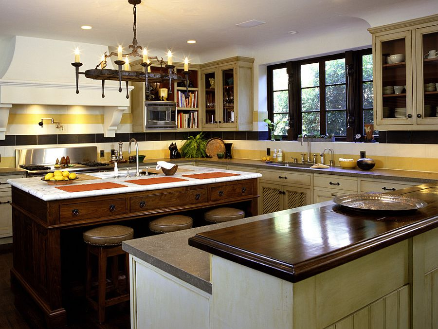 Classy Mediterranean kitchen with a striped backsplash [Design: Tommy Chambers Interiors]