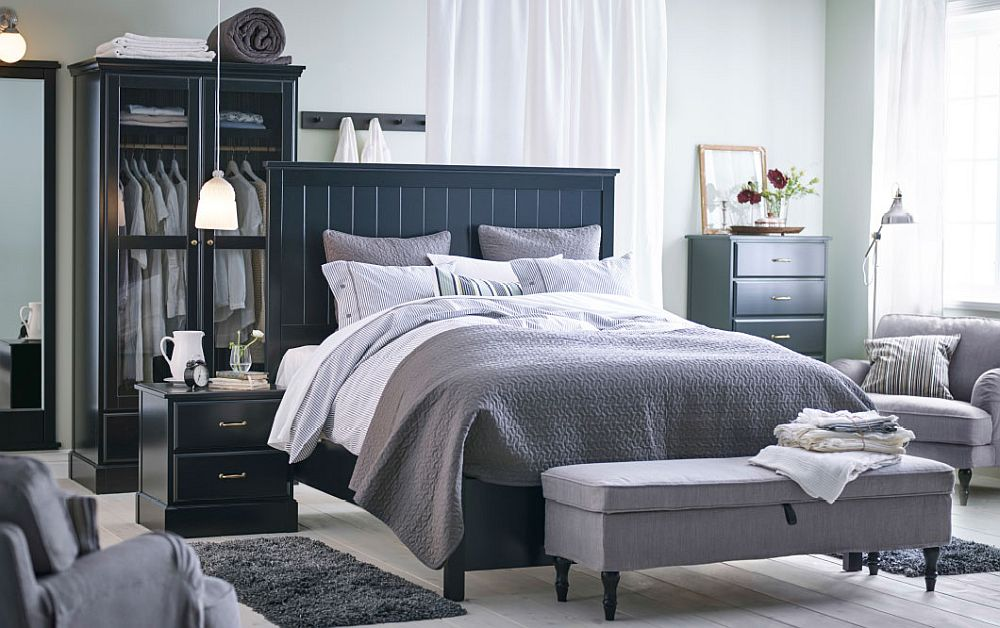 Classy UNDREDAL bed frame adds dark elegance to the bedroom