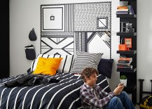 Clean black and white look in the nedroom with a dash of yellow