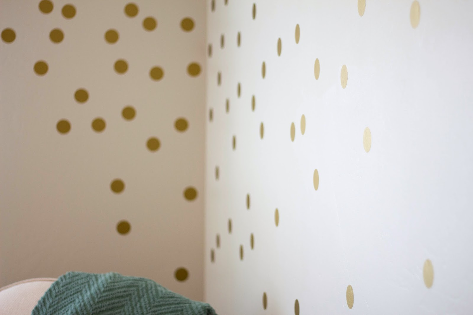 Close up of gold polka dot wall decals
