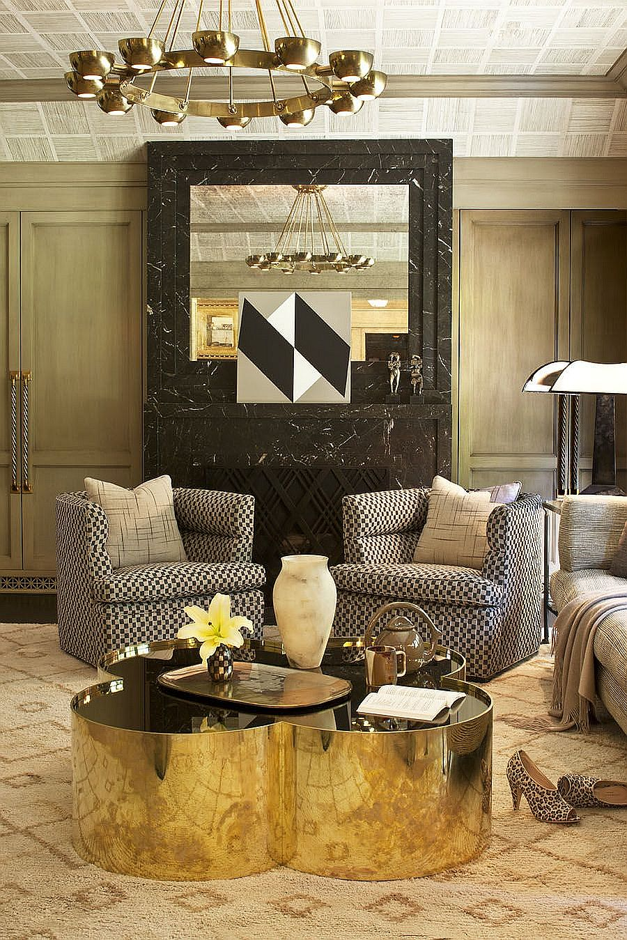 Coffee table brings geometric contrast to the elegant living space [Design: Kelly Wearstler Designs]