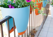 Colorful planters that sit on your balcony railing 217x155 Creative Outdoor Accessories to Hang from Your Balcony Railing