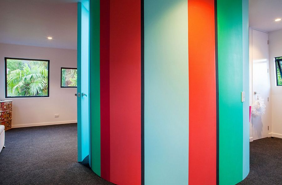 Colorful tube structure acts as the kids' bathroom