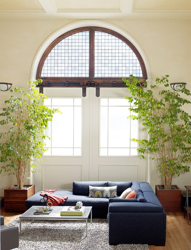 Comfy sectional and greenery create a refreshing ambiance indoors [Design: Kristina Wolf Design]