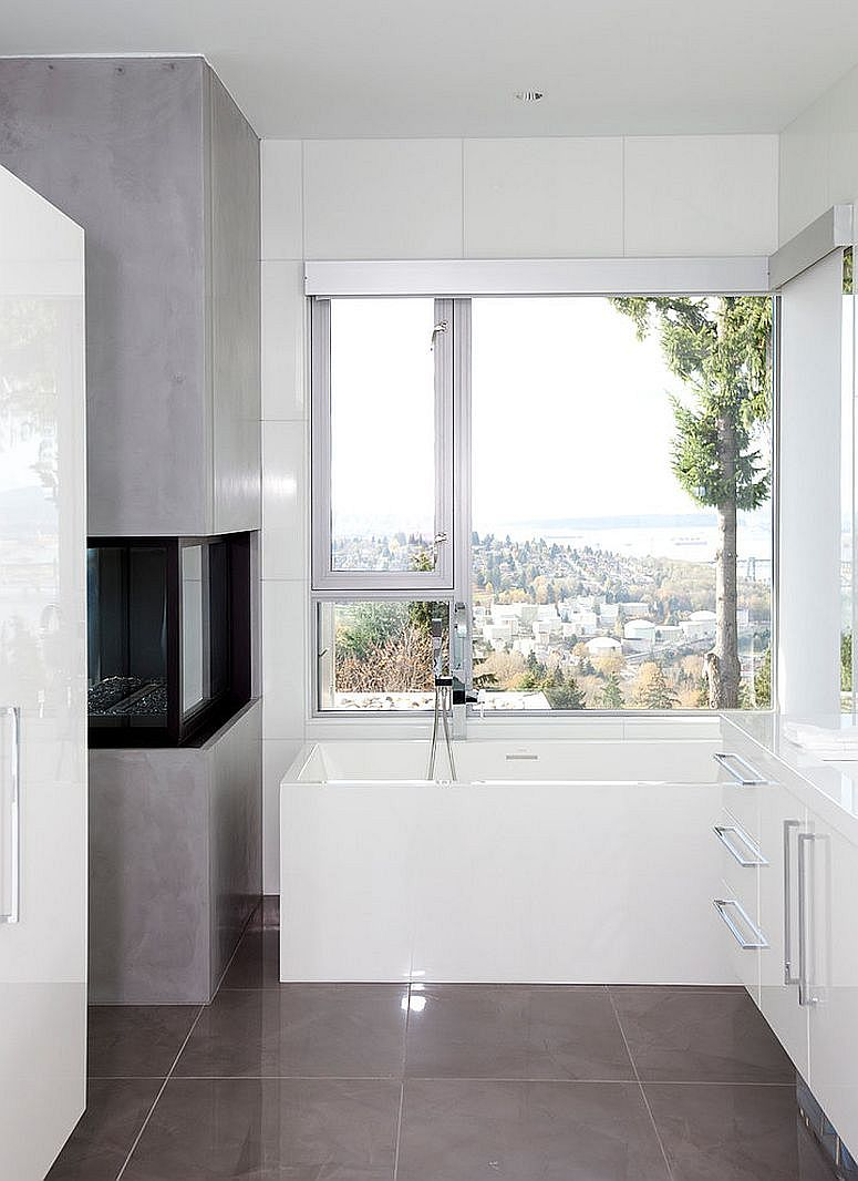 Compact contemporary bathroom with fireplace makes use of every inch of space [Design: Tanya Schoenroth Design]