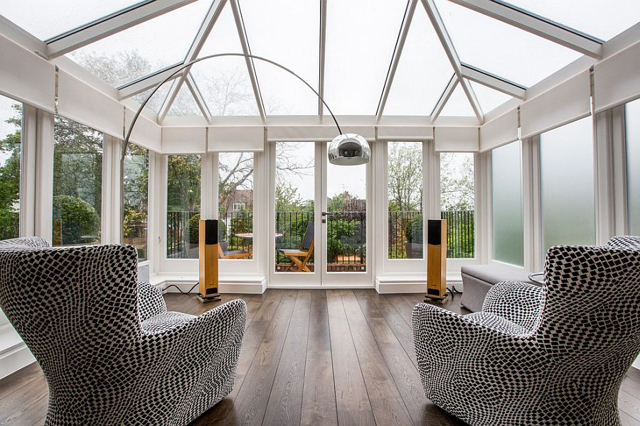 Conservatory for London home with plush seating [Design: Inspired Dwellings]