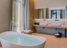 Contemporary bathroom with a standalone bathtub and a sleek vanity with twin sinks