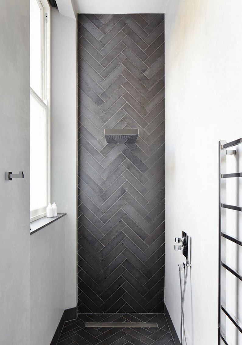 Contemporary shower featuring herringbone tile decoist for Modern bathroom wall tile designs