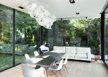 Contemporary sunroom with brilliant chandelier and dining space [Design: StudioP - Julie Engels]