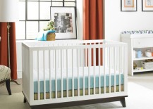 Convertible crib with a dark base