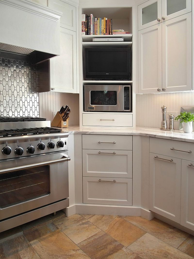 Corner microwave cabinet in the kitchen with shelves above and drawers below [Design: Donna DuFresne Interior Design]