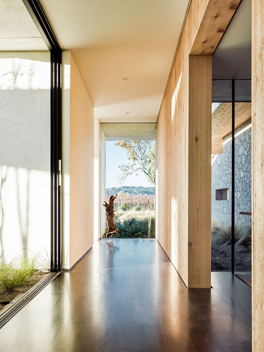 Corridors and walkways connect the two different wings of the house in stone and wood