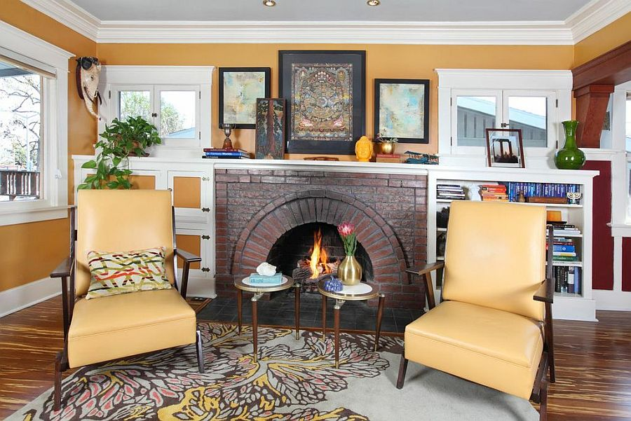 Cozy fireplace in the living room with twin chairs 1918 Hollywood Craftsman Bungalow Gets a Curated, Eco Friendly Makeover