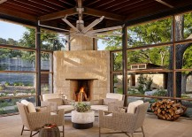 Cozy sunroom with a limestone fireplace