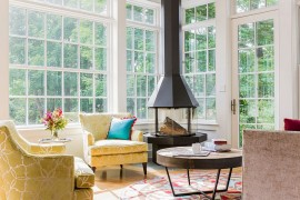 Cozy yellow chairs and freestanding fireplace for the sunroom / family room [Design: LDa Architecture & Interiors]  50 Bright and Beautiful Contemporary Sunrooms Cozy yellow chairs and freestanding fireplace for the sunroom family room 270x180